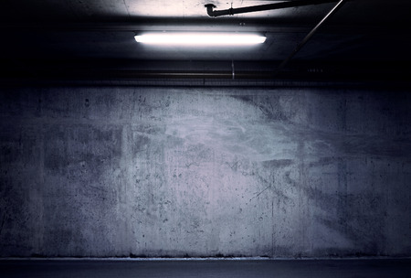 celling: Urban underground background. Concrete wall under the lamp light in the dark