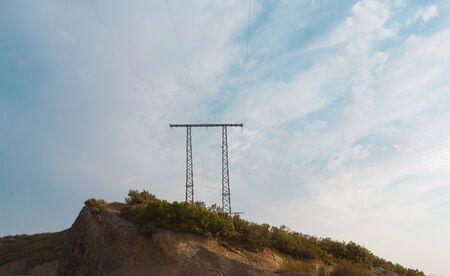 electricity transmission pylon against blue sky.