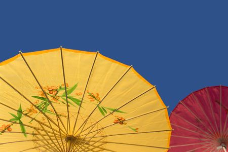 Yellow and Red Parasol Against the Sky photo