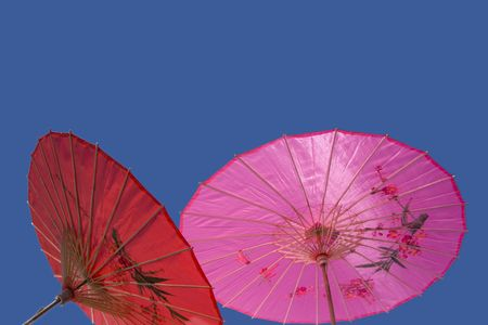 Red and Pink Parasol Against the Sky photo
