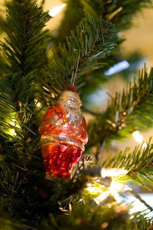 st nick: Antique Santa Clause Christmas tree ornament among tree branches (3446) Stock Photo