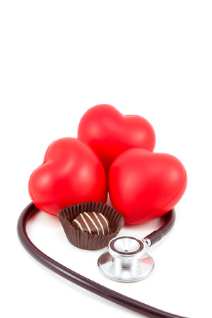 Dark chocolate candy with heart and stethoscope