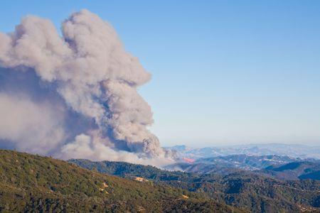DC-10 drops fire retardant on the Lick Fire in California