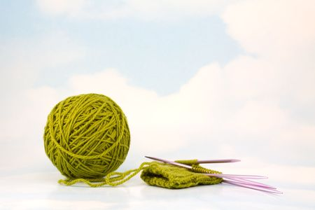 purl: In Progress Green Mitten on Sky Background
