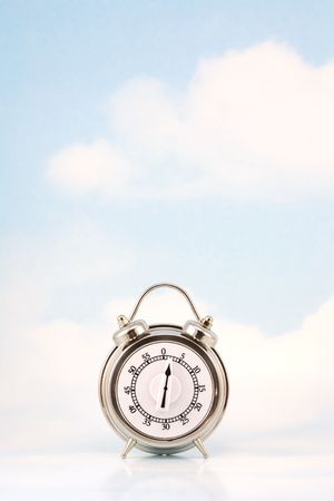 Retro style timer against sky background with clouds
