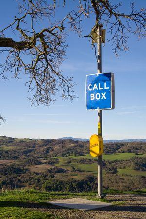 emergency call: An emergency call box in rolling hills of oaks