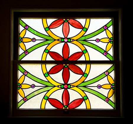 stained glass windows: Stained Glass Window of Stylized Red and Yellow Flowers Stock Photo