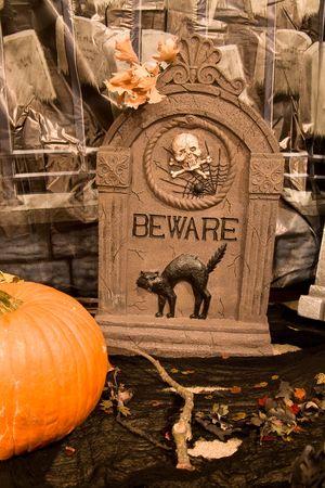 Creepy Halloween Graveyard Scene with Oak Leaves and Pumpkin photo