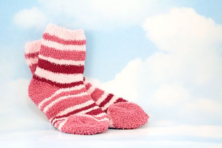 Pair of Pink and White Striped Socks on Sky Background