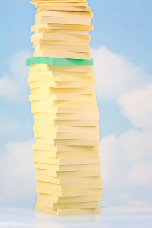 Green Stick Note Pad stacked in Tower of Yellow Ones photo