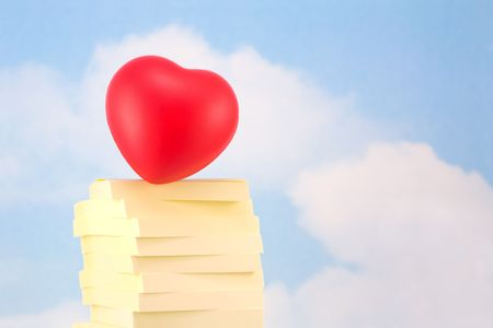 office romance: Heart on Stack of Sticky Notes, Representing Office Romance, on Sky Background