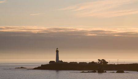 A Pacific Coast Lighthouse at Sunset with Clouds