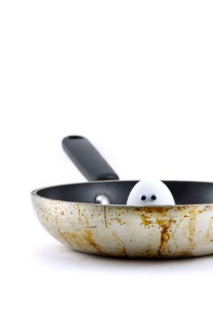 An Egg Peeking Out of a Frying Pan Stock Photo - 2314610