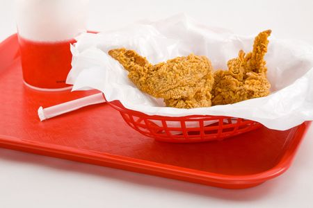 Junkfood in a Basket on a Red Tray with Drink and Straw Stock Photo