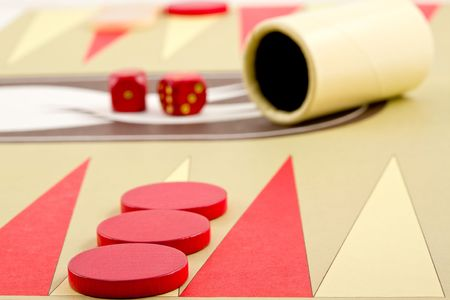 Closeup of Backgammon Board with Pieces, Dice, and Cup