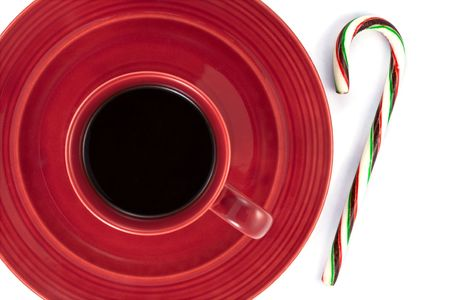 Cup of Coffee on Saucer with a Candy Cane Stock Photo
