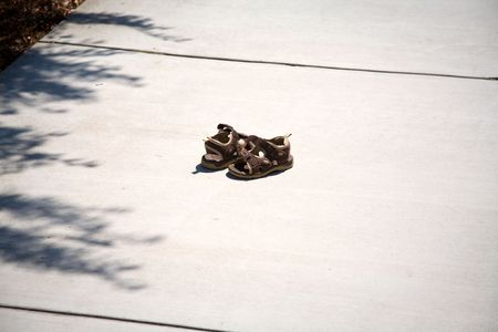 sandles: A Pair of Childs Shoes Lost on the Sidewalk