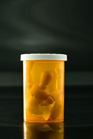 Wooden Artist Model Squashed into Prescription Bottle