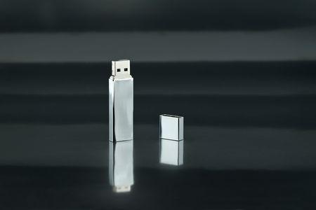 A Chrome USB Thumb Drive on Black Background