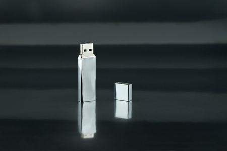 A Chrome USB Thumb Drive on Black Background