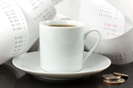 Coffee Cup, Change and Adding Machine Tape photo