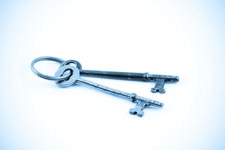Closeup of Skeleton Keys Isolated on White in Blue Tone photo