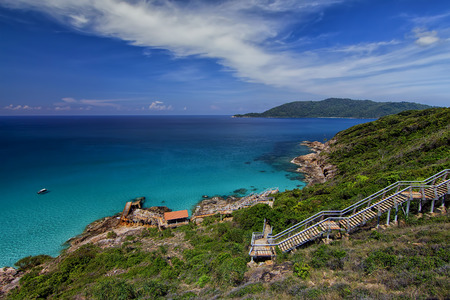 Landscape of Pulau Perhentian Kecil with staircase towards damaged jetty Stock Photo