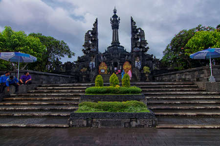 Bali, Indonesia - November 23rd, 2017: Great architectural design of an enterance to a museum in Bali. Its is well guarded by the local authorities for the touristi safety assuarance.