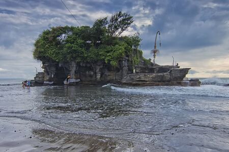 Nature view of the main temple of Tanah Lot in Bali. Observed that the tourist was trying to cross the sea to reach the temple