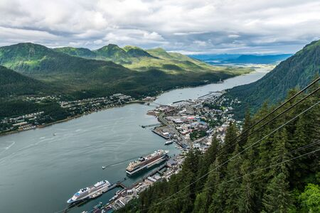 Juneau sits below a high forested mountain along the waters of Gastineau Channel in the Inner Passage of Alaska