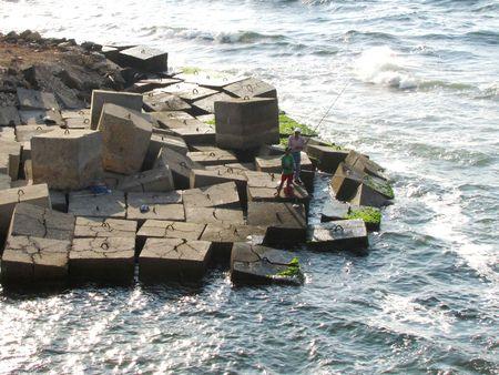 alexandria egypt: Fishermen on wave barrier, Alexandria, Egypt