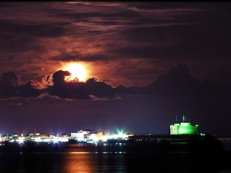 alexandria: Moon over Qaitbay Citadel and Alexandria skyline by night