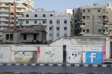 alexandria: Alexandria, Egypt - July 15, 2011 - Egyptians express their views using graffiti. Here, the artist is celebrating the role of Facebook in helping the demonstrators achieve victory. Arabic text translation: Freedom