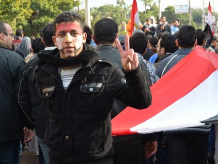 egypt revolution: Alexandria, Egypt - January 27, 2012 - Egyptian Flashing Victory Sign in a Revolution Celebration
