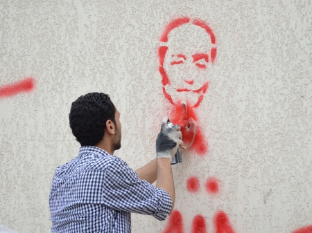 Alexandria, Egypt - April 20, 2012 - Egyptian graffiti artist critizing Military Council