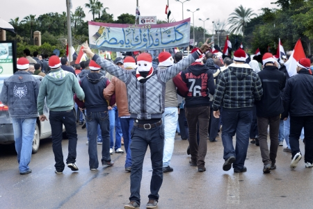 protestor: Alexandria, Egypt - January 27, 2012 - Egyptian protestor flash victory sign Editorial