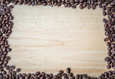 Roasted coffee beans on wood tables and copy space