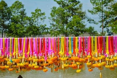 Marigold flower garland hang on colorful rails
