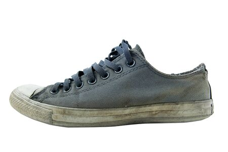 Dirty old sneakers on a white background and clipping path