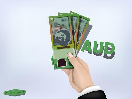 australian dollars money paper on hand,cash on hand