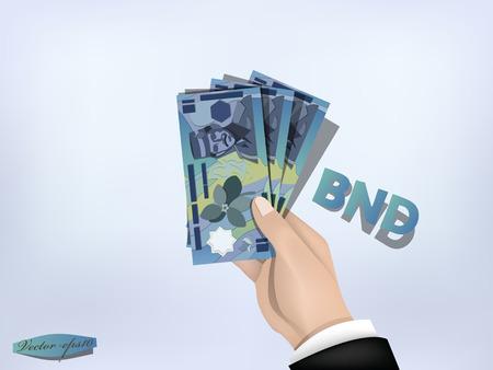 brunei: brunei dollars money paper on hand,cash on hand