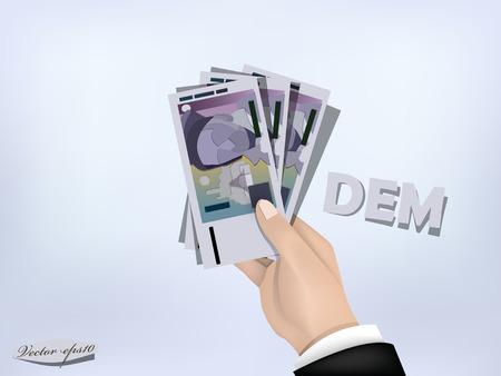 german mark: deutsche mark money paper on hand,cash on hand