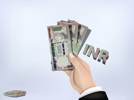 efectivo: papel moneda rupia india en la mano, el efectivo en caja
