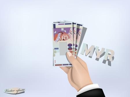 マレーシア ・ リンギットの金紙の手に、手持ちの現金 写真素材 - 37653121