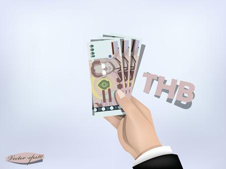 タイのバーツの金紙の手に、手持ちの現金