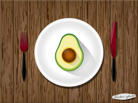 wood table: half avocado on wood table