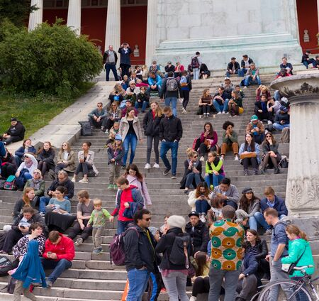 theresienwiese, munich, germany, 2019 april 27: people taking a brake at a Jumble sale, flea market in bavaria at the theresienwiese in munich