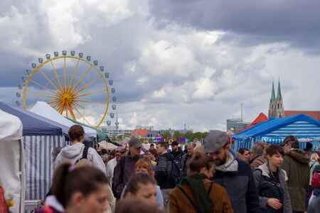 theresienwiese, munich, germany, 2019 april 27: Jumble sale flea market in bavaria at the theresienwiese in munich with a ferris wheel in the background