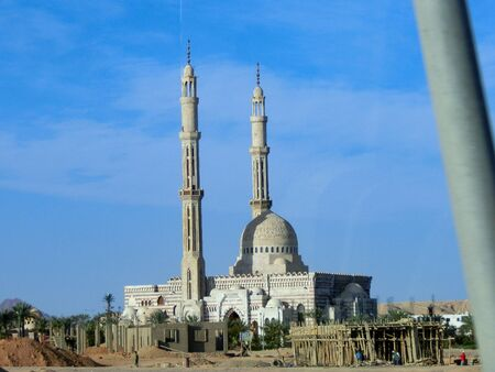 Dahab, Egypt - March 15 ,2012: mosque with minaret lit next to a house of a poor family Editorial