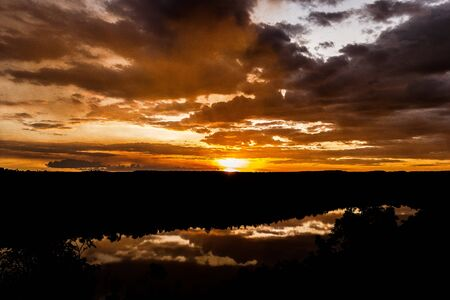 shot through tress of a beautiful sunset in the australian outback with 1 lakes, Nitmiluk National Park
